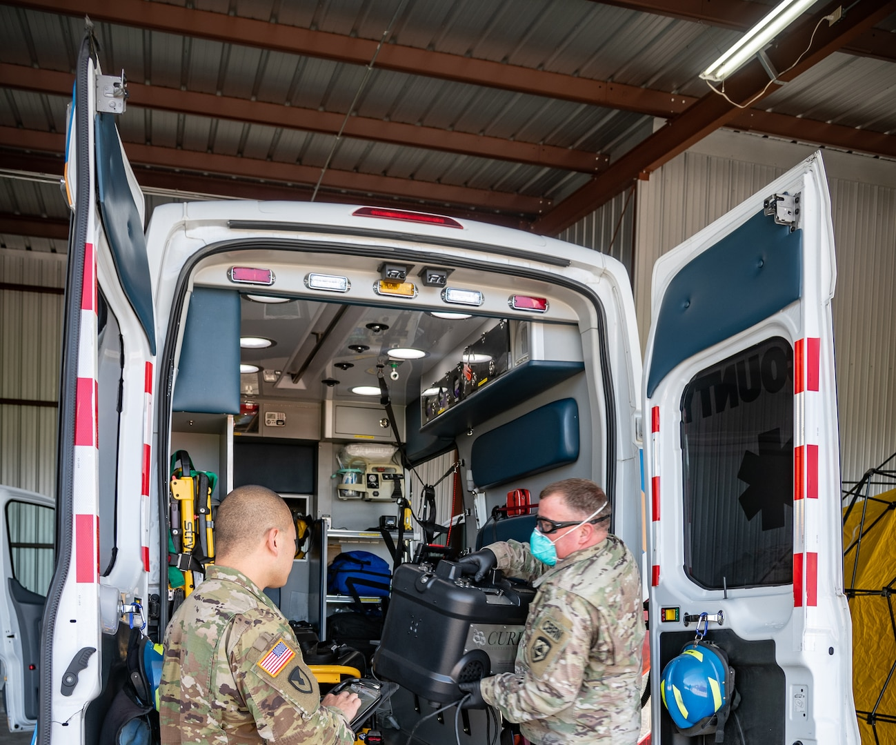 Members of the West Virginia National Guard perform COVID-19 decontamination of first responder vehicles with an Aerosolized Hydrogen Peroxide system at Yeager Airport, Charleston, West Virginia, April 14, 2020. The method will be used to sanitize more than 250 police vehicles and ambulances in the area.