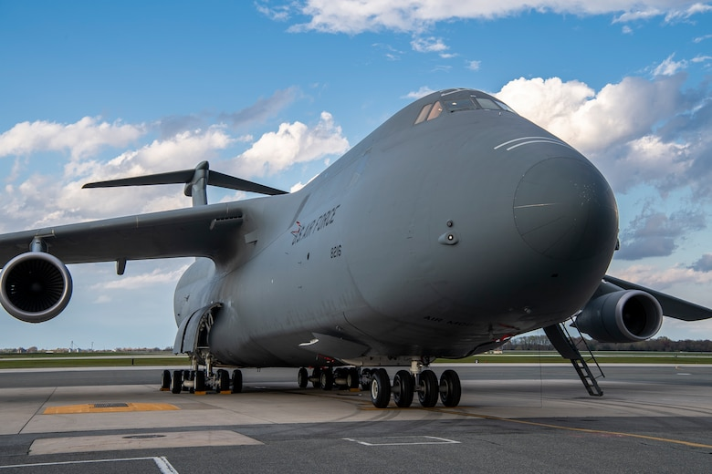 A C-5C Space Cargo Modified Galaxy from Travis Air Force Base, California, is parked on the flight line at Dover AFB, Delaware, April 8, 2020. The C-5C SCM has the troop compartment removed and a modification to the rear loading doors. It is specially modified to carry satellites and other large cargo. (U.S. Air Force photo by Senior Airman Christopher Quail)