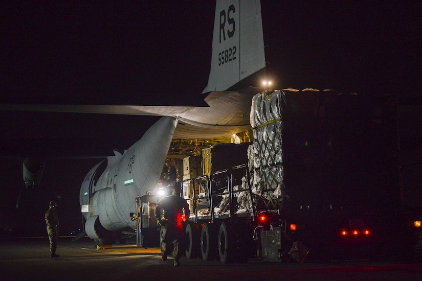 A vehicle is loaded with cargo from an aircraft.