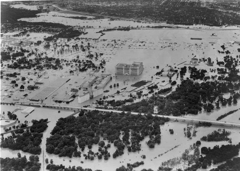 Aerial photo of 1949 flood along W. 7th St., Fort Worth, Montgomery Ward store in center