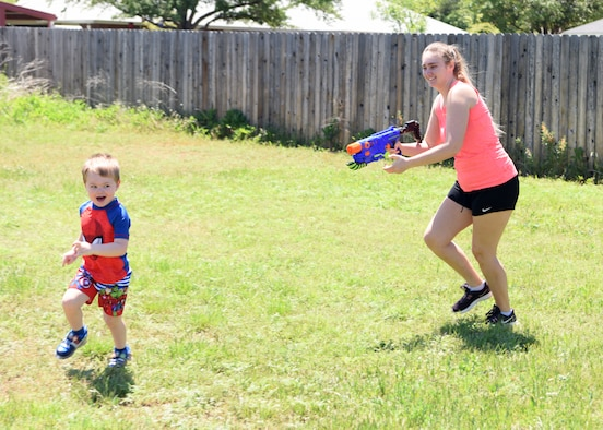 Sydney Sherwood squirts Colby, 3, with a water gun in San Angelo, Texas, April 16, 2020. Water guns have been popular since the late 1800s and remain a popular pastime on hot days. (U.S. Air Force photo by Airman 1st Class Ethan Sherwood)