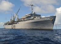 ULITHI, Yap (Dec. 7, 2019) – The submarine tender USS Emory S. Land (AS 39) sits anchored at Ulithi Atoll, Dec. 7. Land is deployed to the U.S. 7th Fleet area of operations to support theater security cooperation efforts in the Indo-Pacific region. (U.S. Navy photo by Mass Communication Specialist 2nd Class Richard A. Miller/Released)