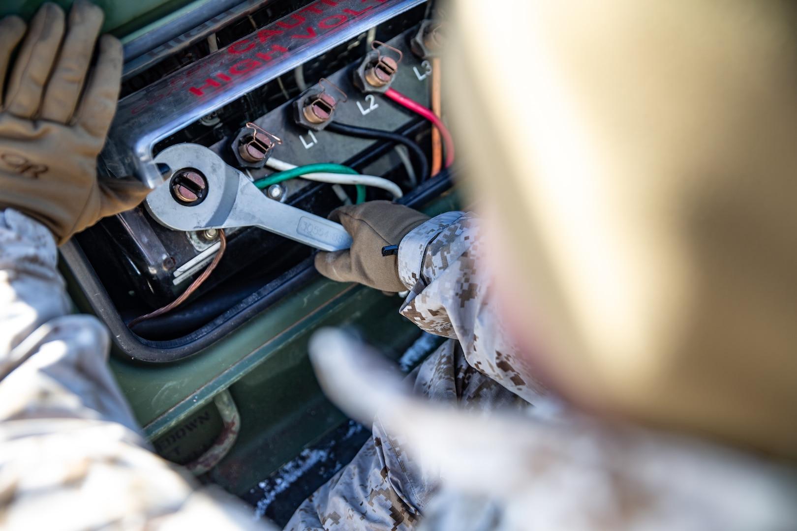 A U.S. Marine wires load-studs during exercise Northern Viper on Yausubetsu Training Area, Hokkaido, Japan, Jan. 16.