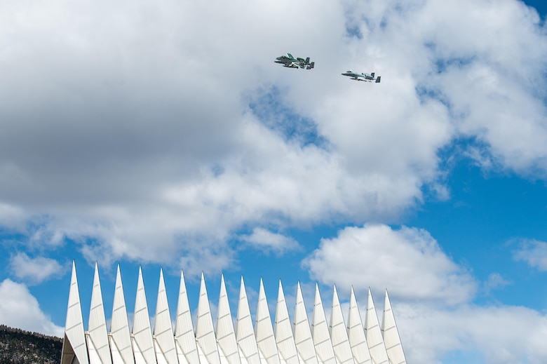 A photo of aircraft flying over the US Air Force Academy