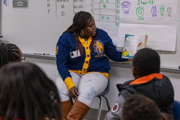 Shop 67 Angel Eure has been participating in the tutoring program at Norfolk Naval Shipyard for four years and is the Tutorial Program Champion for James Hurst Elementary School. She represented America's Shipyard at James Hurst Mar. 2 as part of Read Across America Day.