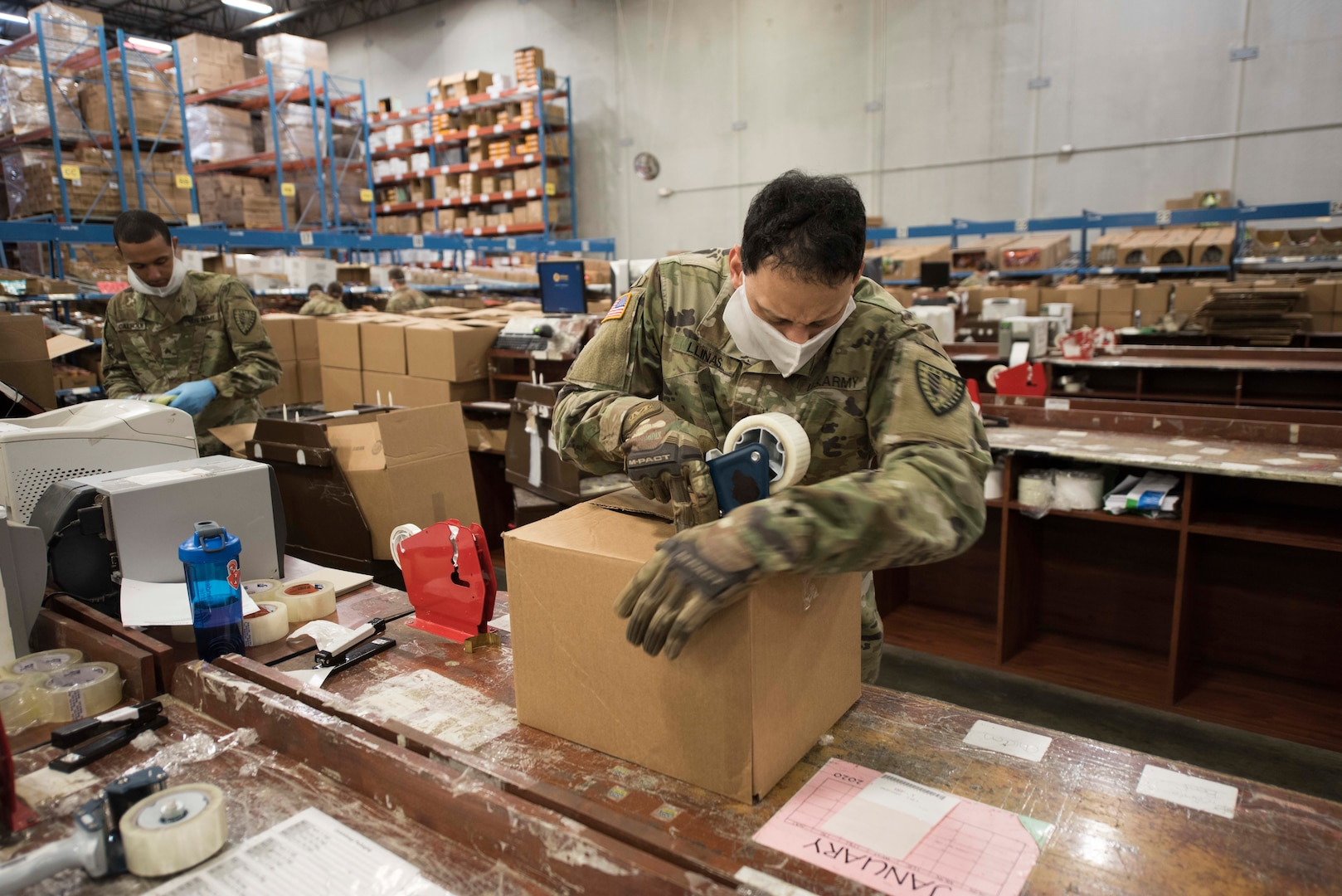An Indiana National Guard Soldier from the 38th Sustainment Brigade packs commissary orders for Indiana offenders at the Plainfield Correctional Facility, Plainfield, Indiana, April 14, 2020.