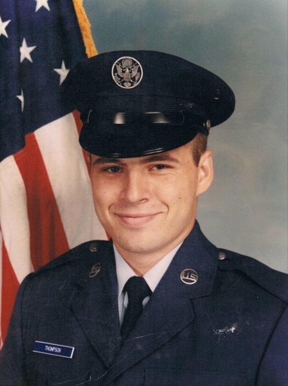 Then U.S. Air Force Airman John Thompson poses for his official photo at Lackland Air Force Base, Texas, July 1983.