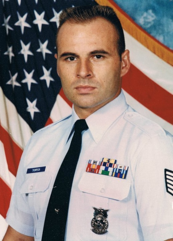 Then U.S. Air Force Tech. Sgt. John Thompson has his official photo taken at Anderson Air Force Base, Guam, 1994.