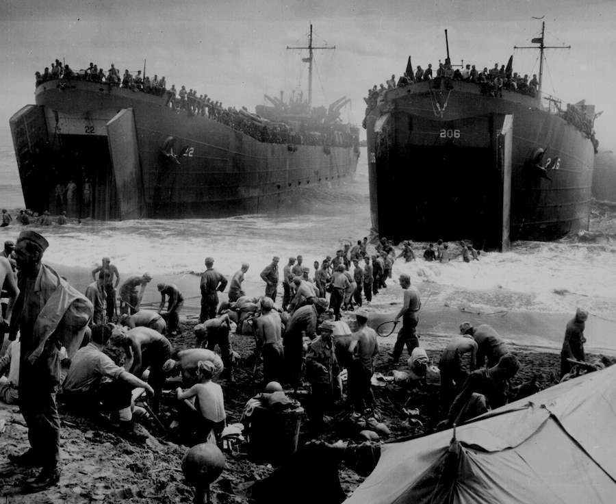 U.S. troops unload equipment from two Coast Guard tank landing ships on the beach of Leyte Island in the Philippines during the Pacific campaign in 1944.