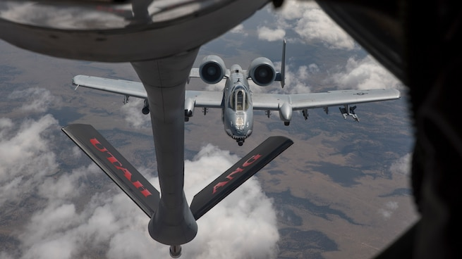 A KC-135R assigned to the Utah Air National Guard's 151st Air Refueling Wing conducts air refueling operations with A-10s