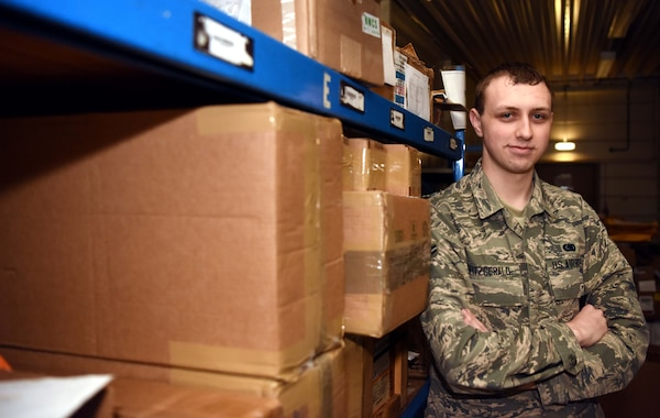 Airman 1st Class Patrick Fitzgerald, 100th Logistics Readiness Squadron flight service center technician, poses for a photo at RAF Mildenhall, England, April 15, 2020. The FSC Airmen are a part of materiel management and are tasked with managing and distributing Air Force assets to various units. (U.S. Air Force photo by Senior Airman Brandon Esau)