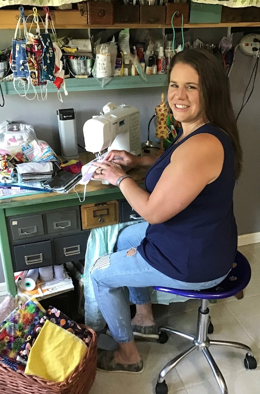 Amanda Peterson, spouse of U.S. Air Force Tech. Sgt. Parker Peterson, crafts masks to help those in need at and around Little Rock Air Force Base, Arkansas.