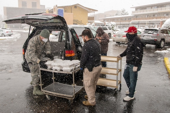 U.S. Air Force Airman 1st Class John Boyle, 233rd Space Group security forces specialist, Colorado Air National Guard, Greeley, gathers meals for people experiencing homelessness as a result of COVID-19 at a hotel in Denver, April 16, 2020.