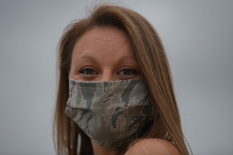 Kelly Miller, Dyess Spouse's Club president, smiles under a face-mask at Dyess Air Force Base, Texas, April 14, 2020.