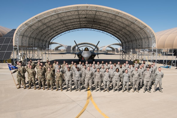 Members of the 51st Network Operations Squadron stand for a group photograph at Joint Base Langley-Eustis, Virginia, March 8, 2020, prior to social distancing guidelines issued as a response to COVID-19. In any given month, the 51st NOS convenes its forces to employ the Cyber Security Control System's capabilities and execute U.S. Cyber Command taskings across several missions. (U.S. Air National Guard photo by Staff Sgt. Lucretia Cunningham)