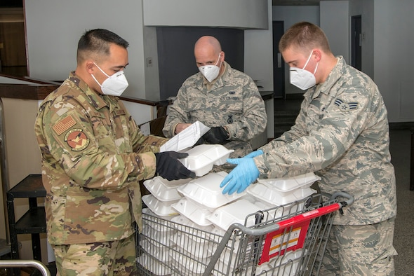 U.S. Air Force Master Sgt. Curtis Hansen (left), Airman 1st Class John Boyle, both 233rd Space Group security forces specialists in Greeley, Colorado, and Senior Airman Konnor Ewing,  140th Wing, Colorado Air National Guard aircraft structural maintenance mechanic in Aurora, Colorado, put together lunch meals for people experiencing homelessness as a result of COVID-19 at a hotel in Denver, April 16, 2020.  Colorado National Guard members have answered the call to serve in one of a multitude of task forces that have been deployed around the state in various capacities to support state and local officials to combat the coronavirus pandemic. (U.S. Air National Guard photo by Senior Master Sgt. John Rohrer)