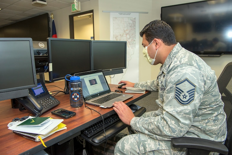 Airman working on Coputer in emergency operations center