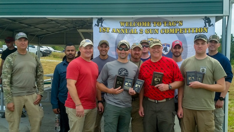 Current and retired members of the Kentucky Air National Guard competed at the Adjutant General's Two-Gun Pistol and Rifle Scramble match at the Wendell H. Ford Regional Training Center Sept. 26, 2019. Back row from left to right: John Siebert, Miah Helm, Eric Skaggs, Frank Tallman (retired), Jacob Faith, Yuri Motamedi and Frank Morgan. Front row from left to right: Kevin Krauss, David Farc, Darryl Loafman and Austin Goldman. Farc took Two-Gun Top Gun, followed by Loafman and Goldman. (Courtesy Photo)