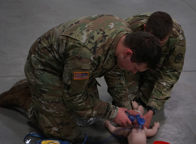 Soldiers and Airmen from the Pennsylvania National Guard perform the written evaluation of the American Red Cross CPR certification on April 13, 2020