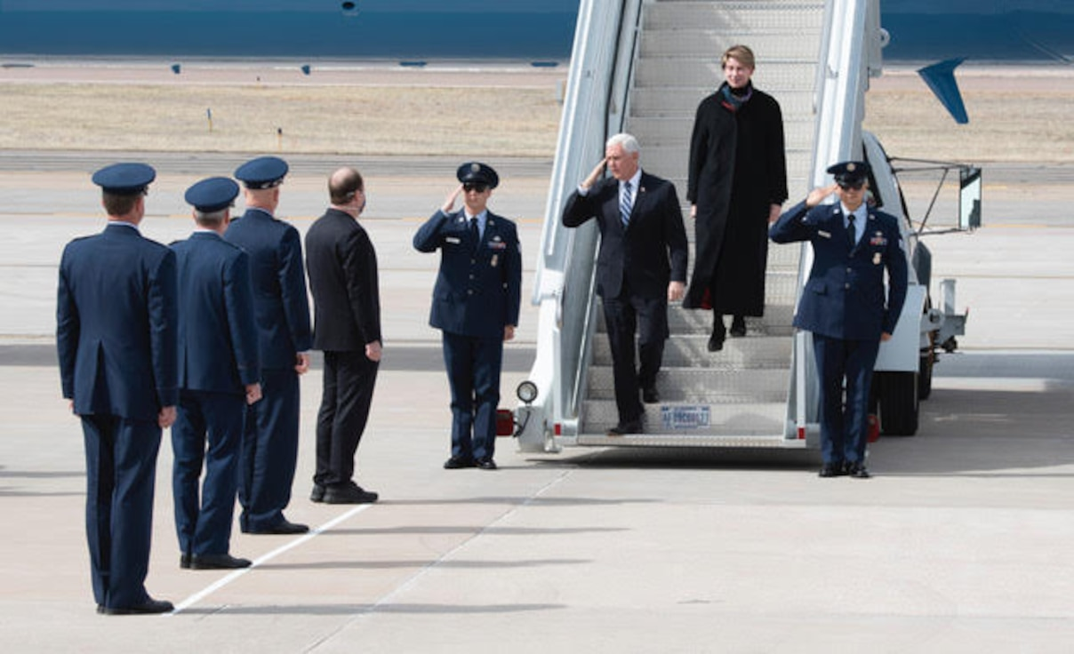 """PETERSON AIR FORCE BASE, Colo. – Vice President Mike Pence greets Colorado Governor Jared Polis, General John """"Jay"""" Raymond, and U.S. Space Force Chief of Space Operations and commander of U.S. Space Command, General Terrence O'Shaughnessy, commander of U.S. Northern Command and Northern American Aerospace Defense Command, and Col. Thomas Falzarano, 21st Space Wing commander, as he exits his aircraft on Peterson Air Force Base, Colorado, April 18, 2020. Pence came to Colorado Springs to speak at the U.S. Air Force Academy graduation which included 86 cadets from USAFA to commission directly into the U.S. Space Force, becoming the very first company grade officers in the new service. (U.S. Air Force photo by Staff Sgt. Alexandra M. Longfellow)"""
