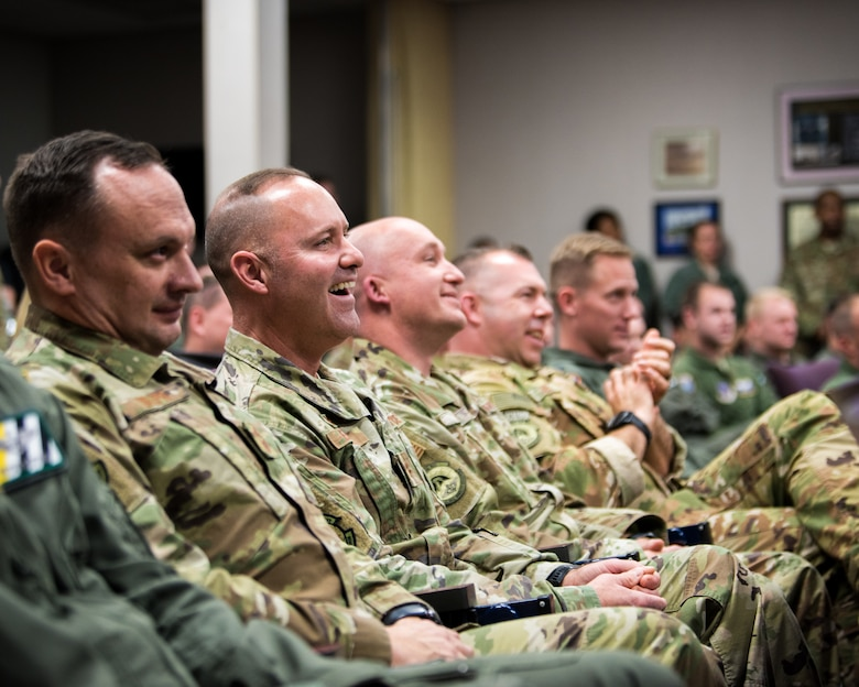 Audience members react as Chief Master Sgt. Jeffrey Brown talks about his 38-year career during his retirement ceremony at the Kentucky Air National Guard Base in Louisville, Ky., Dec. 7, 2019. (U.S. Air National Guard photo by Senior Airman Chloe Ochs)