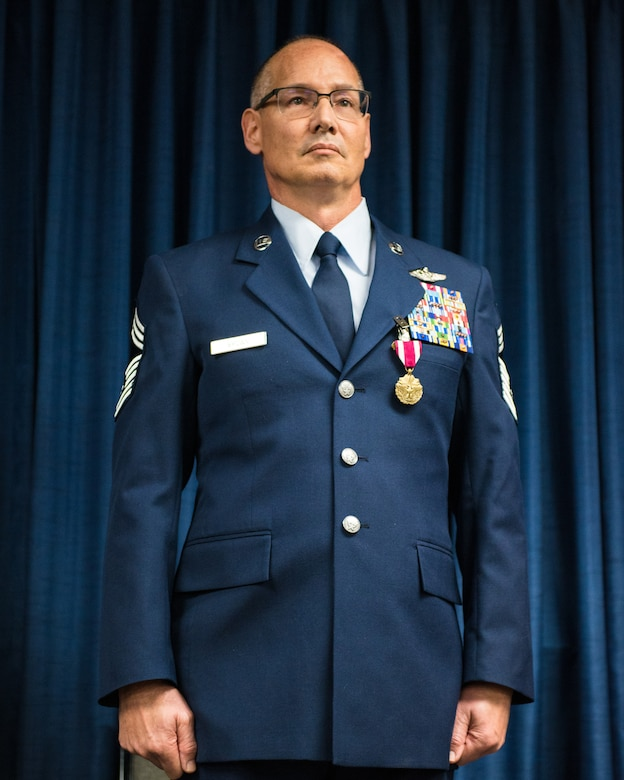 Chief Master Sgt. Jeffrey Brown, a loadmaster supervisor with the 165th Airlift Squadron, retires from 38 years of military service during a ceremony at the Kentucky Air National Guard Base in Louisville, Ky., Dec. 7, 2019. (U.S. Air National Guard photo by Senior Airman Chloe Ochs)