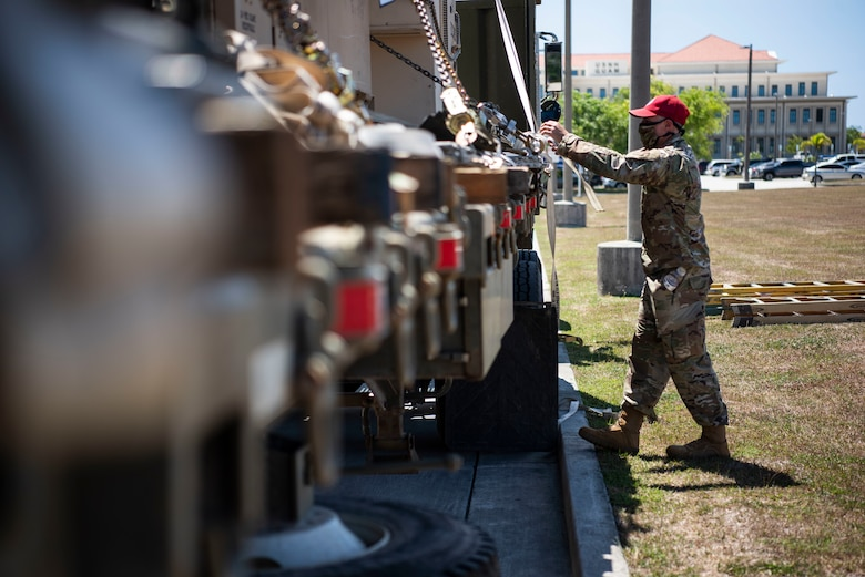 An Airman from the 554th RED HORSE Squadron prepares to unload medical supplies for the Expeditionary Medical Support System facility April 13, 2020, at U.S. Naval Hospital Guam.