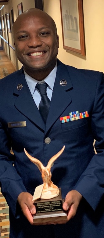 Staff Sgt. Maurice Roberson, 104th Fighter Wing paralegal, poses for a photo with his distinguished honor graduate trophy after graduating from the Air Force Judge Advocate General School, Montgomery, Alabama. Roberson received the award of distinguished honor graduate for his outstanding performance at technical school. (courtesy photo)