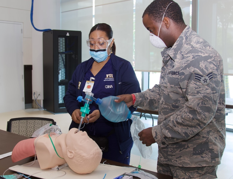 Florida Guard doctors, nurses and medics joined Florida International University (FIU) at the Miami Beach Convention Center (MCC) to conduct refresher training in preparation to staff the MBCC in the event the space is needed for the COVID-19 response. Federal, state and local partnerships are coming together to combat the COVID-19 virus.