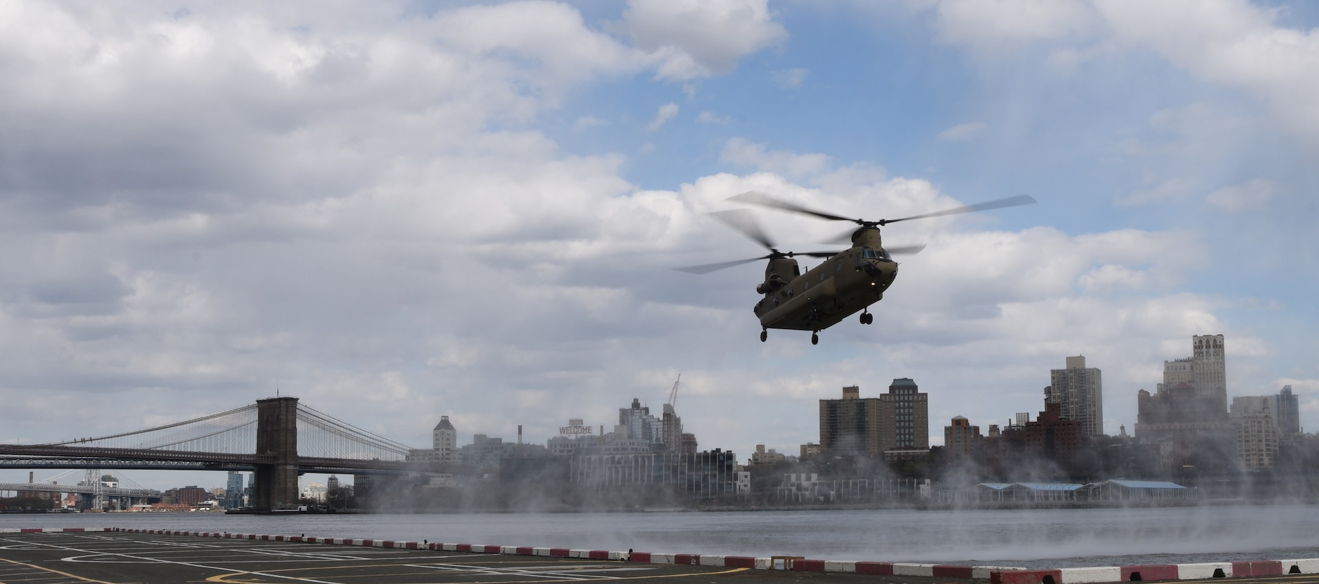 A CH-47 Chinook helicopter, assigned to the New York Army National Guard's Company B, 3rd Battalion, 126th Aviation, approaches a helipad in New York City, April 16, 2020. New York National Guard members are supporting the multi-agency response to COVID-19.
