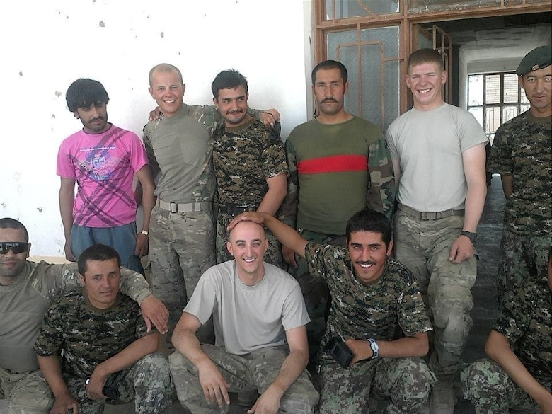 Eleven men pose for picture. Four American Soldiers and seven host nation Afghan Soldiers.