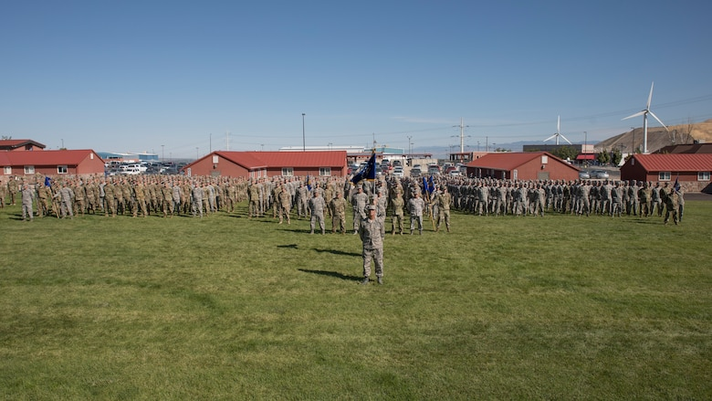 Airmen assigned to the Utah Air National Guard and 151st Air Refueling Wing stand ready for the pass-and-review at the annual Governor's Day celebration at Camp Williams, Utah, September 14, 2019