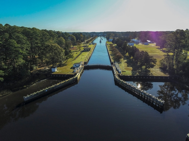 Boats traveling south along the Albemarle and Chesapeake Canal pass through the Great Bridge Locks in Chesapeake, Va.