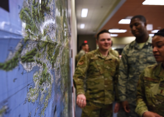 U.S. Air Force students from the 315th Training Squadron participate in Operation Lonestar, the capstone project for the four pipeline intelligence analyst students, in the 313th Training Squadron schoolhouse on Goodfellow Air Force Base, Texas, March 5, 2020. The capstone project is the first time the 315th TRS's All Source Intelligence Analysts, the Geospatial Intelligence Imagery Analysts, Targeting Analysts and Intelligence Officers integrate in one learning environment. Note: This photo was taken before COVID-19 reached Goodfellow, the students and instructors are now practicing precautions and proper safety measures during the capstone. (U.S. Air Force photo by Airman 1st Class Abbey Rieves)