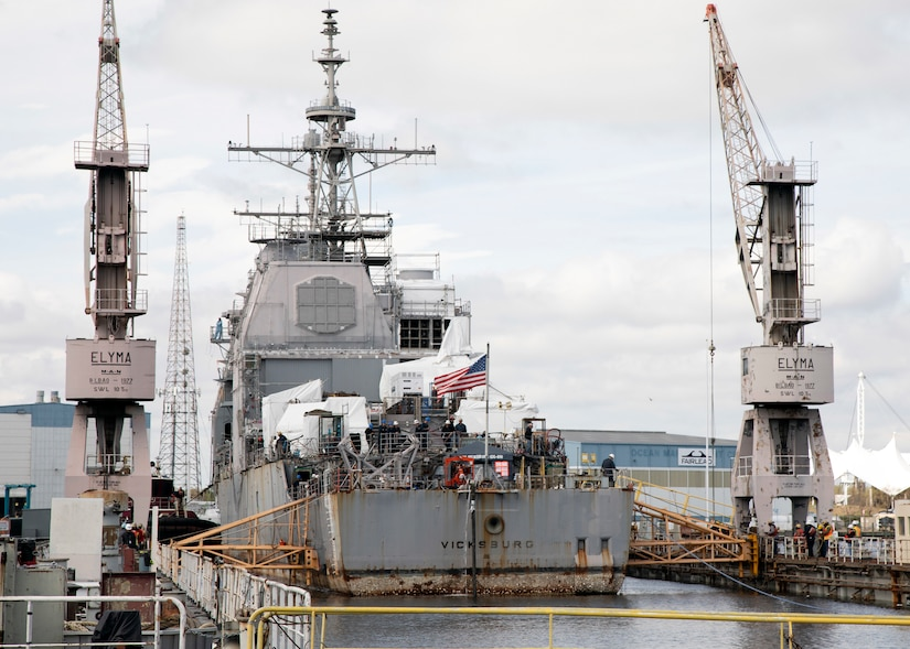 A ship enters dry dock.