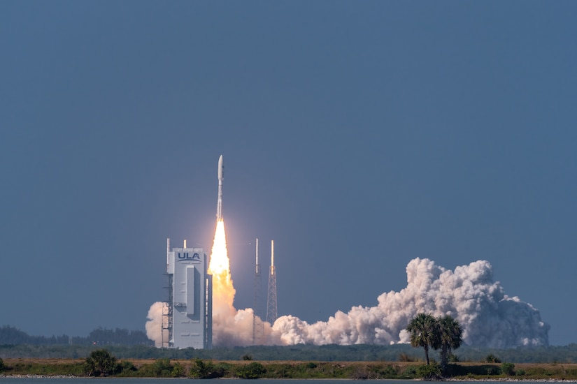 A rocket launches from a launch pad.
