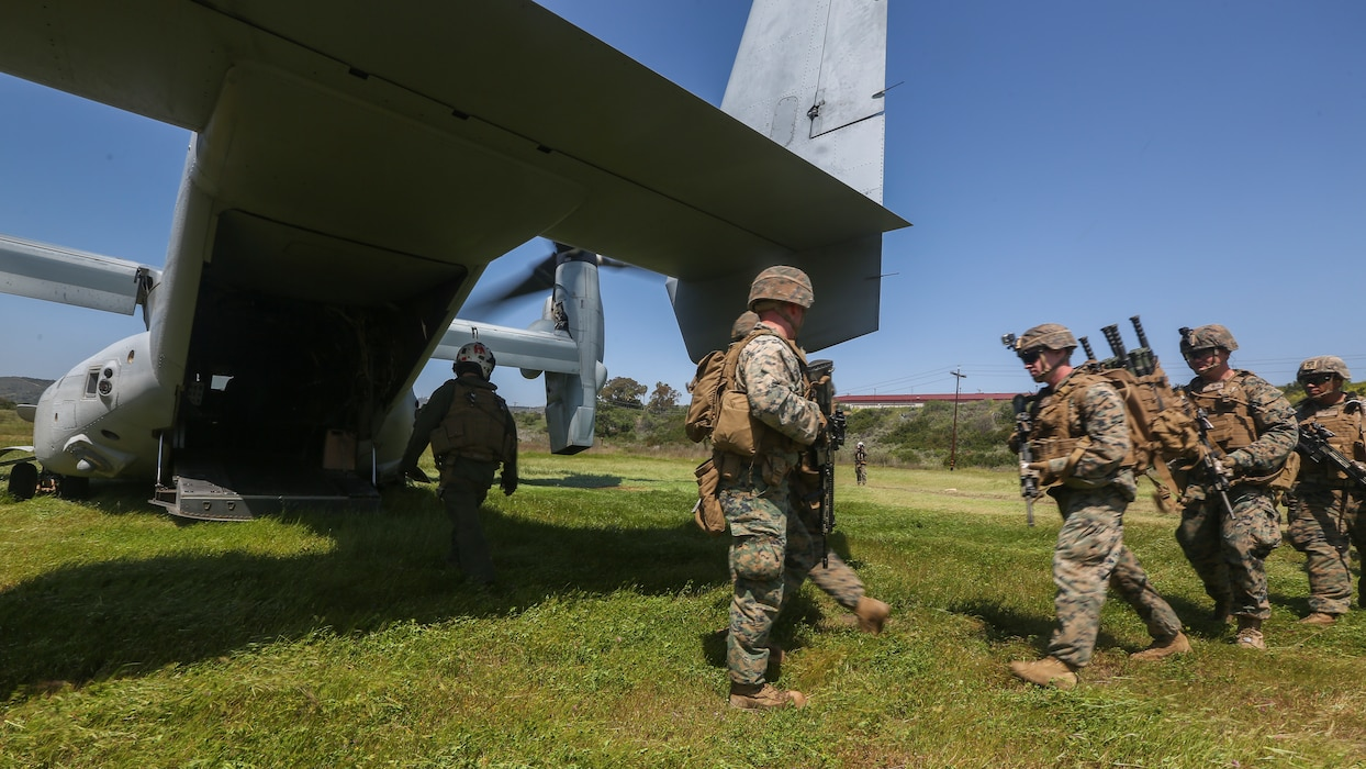 U.S. Marines with Marine Medium Tiltrotor Squadron 165, Marine Aircraft Group 16, 3rd Marine Aircraft Wing (MAW), and 2nd Battalion, 4th Marine Regiment, 1st Marine Division, load a MV-22 Osprey for a Tactical Recovery of Aircraft and Personnel (TRAP) on Marine Corps Base Camp Pendleton, Calif., April 14,2020. The training was held to ensure consistent operational capability, as 3rd MAW remains ready to support short notice, worldwide deployments while following necessary precautions to protect the health of the force. (U.S. Marine Corps photo by Lance Cpl. Jaime Reyes)
