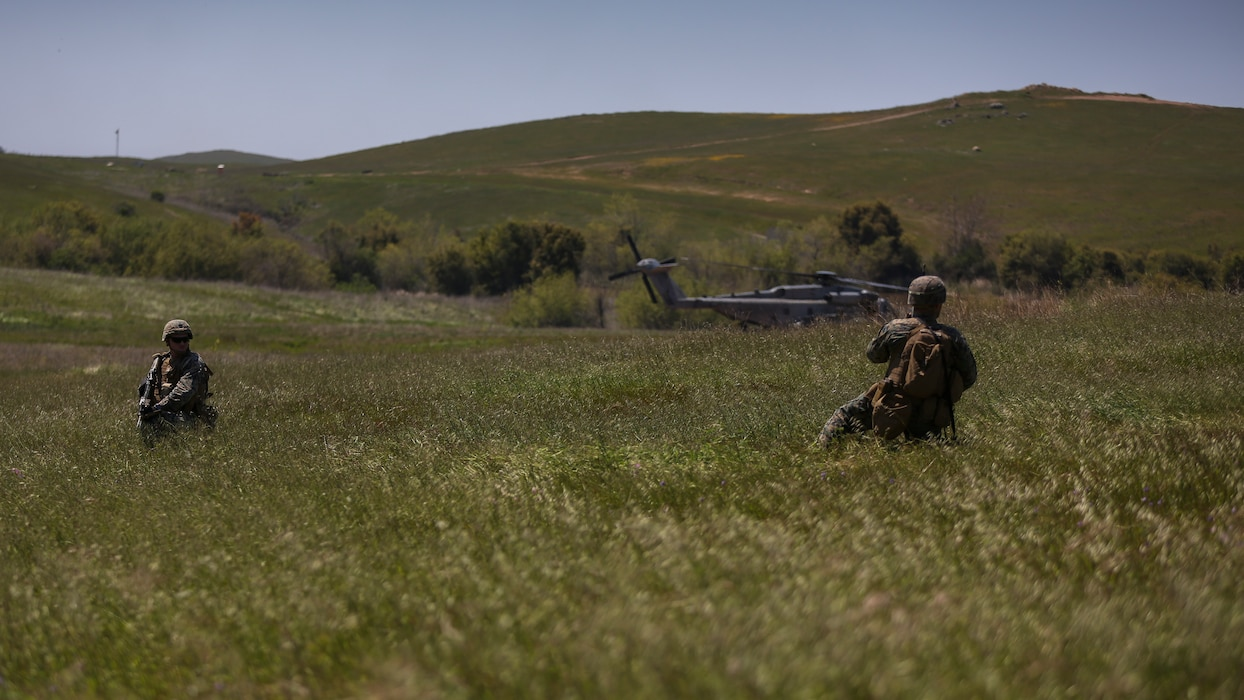 U.S. Marines with 2nd Battalion, 4th Marine Regiment, 1st Marine Division, set up a perimeter for a Tactical Recovery of Aircraft and Personnel (TRAP) on Marine Corps Base Camp Pendleton, Calif., April 14,2020. The training was held to ensure consistent operational capability as 3rd MAW remains ready to support short notice, world-wide deployments while following necessary precautions to protect the health of the force. (U.S. Marine Corps photo by Lance Cpl. Jaime Reyes)