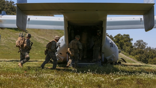 U.S. Marines with Marine Medium Tiltrotor Squadron 165, Marine Aircraft Group 16, 3rd Marine Aircraft Wing (MAW), and 2nd Battalion, 4th Marine Regiment, 1st Marine Division, load a MV-22 Osprey for a Tactical Recovery of Aircraft and Personnel (TRAP) on Marine Corps Base Camp Pendleton, Calif., April 14,2020. The training was held to ensure consistent operational capability, as 3rd MAW remains ready to support short notice worldwide deployments while following necessary precautions to protect the health of the force. (U.S. Marine Corps photo by Lance Cpl. Jaime Reyes)