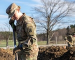 Pfc. Caleigh McLain, an infantry soldier with C Company, 3rd of the 172nd Infantry Regiment (Mountain), and resident of Amherst, digs soil beds in Manchester at the New Hampshire Food Bank garden.