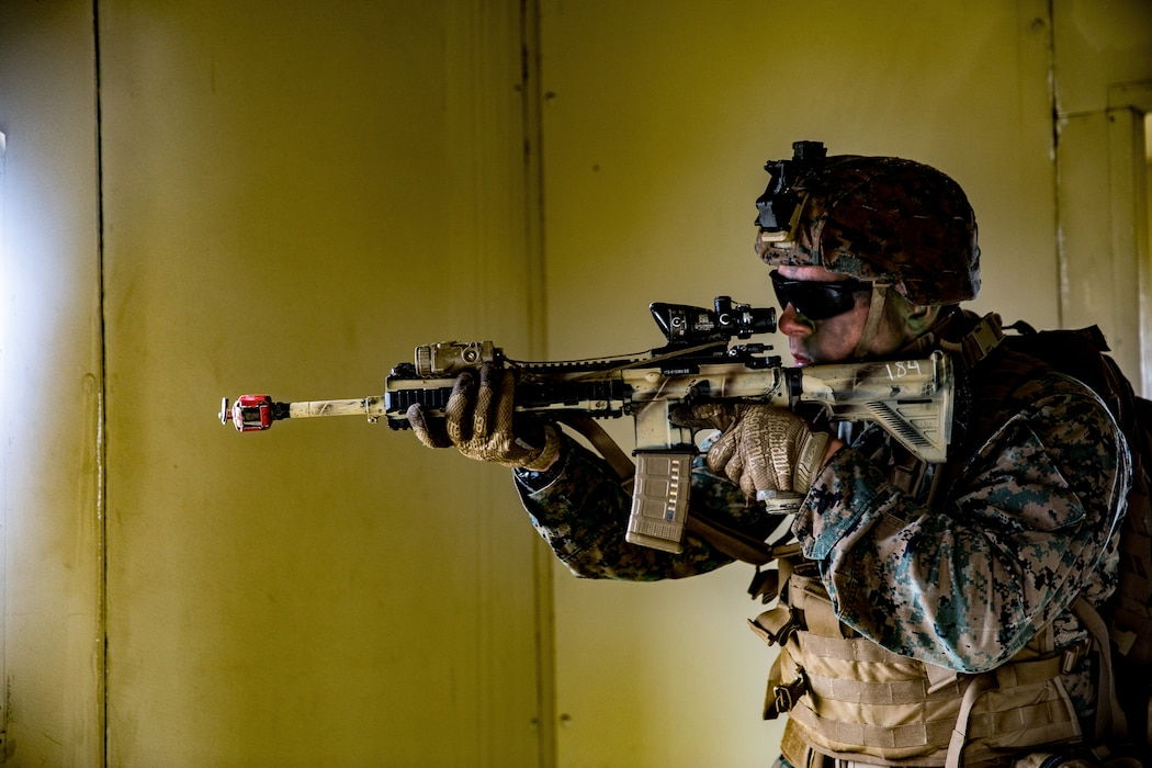 U.S Marine Corps Cpl. Jacob Cimini, a rifleman with Company F, 2nd Battalion, 4th Marine Regiment, 1st Marine Division, sets security during the Expeditionary Operations Training Group evaluation on Marine Corps Base Camp Pendleton, California, March 19, 2020. The Marines of Company F conducted boat raids during both day and night for their culminating exercise in preparation for deployment. (U.S. Marine Corps photo by Lance Cpl. Benjamin Aulick)