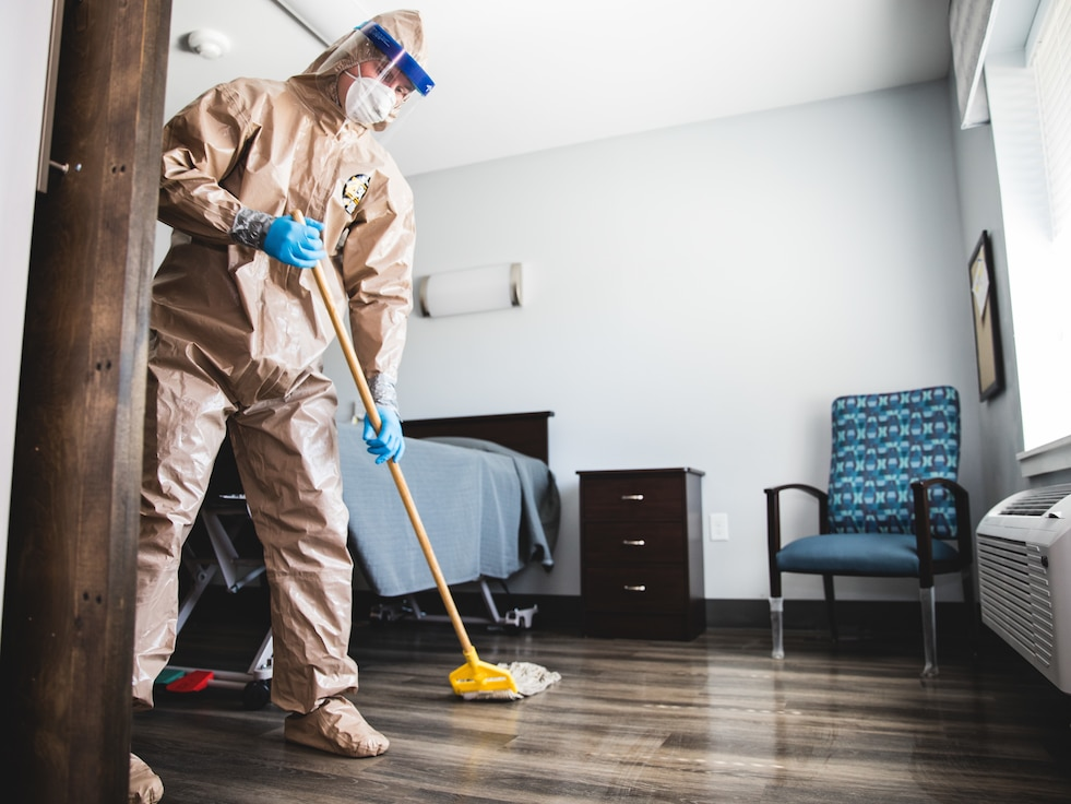 A U.S. Airman with the 116th Air Control Wing (ACW), Georgia Air National Guard, cleans rooms and common areas to assist residents of Southern Pines, a long-term care facility, in Warner Robins, Georgia, April 16, 2020.  Airmen from the 116 ACW volunteered to assist with sanitizing long-term care facilities around Georgia during the Georgia National Guard COVID-19 response. (U.S. Air National Guard photo by 1st Lt. Dustin Cole)
