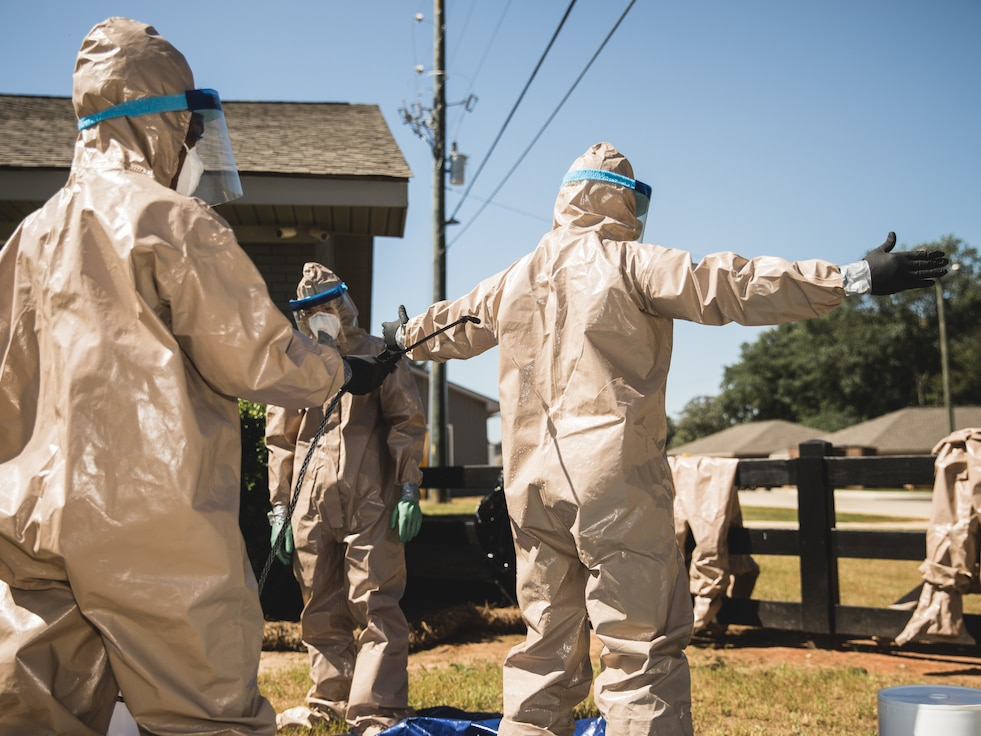 U.S. Airmen with the 116th Air Control Wing (ACW), Georgia Air National Guard, sanitize personal protective equipment and inspect their wingmen upon exiting the Southern Pines, a long-term care facility, in Warner Robins, Georgia, April 16, 2020.  Airmen from the 116 ACW volunteered to assist with sanitizing long-term care facilities around the Georgia during Georgia National Guard COVID-19 response. (U.S. Air National Guard photo by 1st Lt. Dustin Cole)