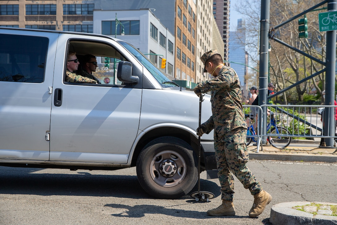 Lance Cpl. Randoll Gonzales, a rifleman with Lima Company, 3rd Battalion, 2nd Marines, Task Force New York, screens vehicles while providing security for the USNS Comfort (T-AH 20) during COVID-19 relief efforts in New York City, April 19, 2020. Comfort cares for trauma, emergency and urgent care patients without regard to their COVID-19 status. Comfort is working with the Javits New York Medical Station as an integrated system to relieve the New York City medical system, in support of U.S. Northern Command's Defense Support of Civil Authorities as a response to the COVID-19 pandemic. (U.S. Marine Corps photo by Sgt. Stormy Mendez)