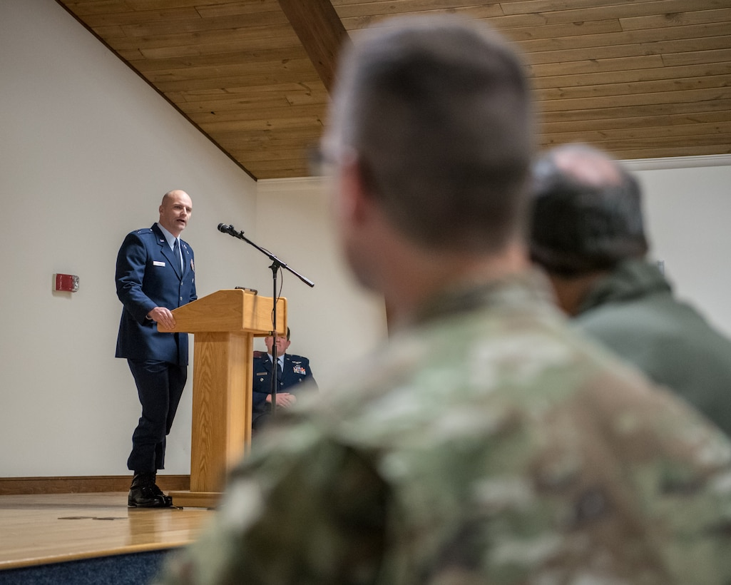 Capt. Russ LeMay, Norse Troop officer in charge for the 123rd Special Tactics Squadron, speaks at the retirement ceremony of Chief Master Sgt. Aaron May, the outgoing chief enlisted manager for the 123rd Special Tactics Squadron, at the Kentucky Air National Guard Base in Louisville, Ky., on Dec. 7, 2019. May is retiring after more than 26 years of service to the Kentucky Air National Guard and U.S. Air Force. (U.S. Air National Guard photo by Staff Sgt. Joshua Horton)