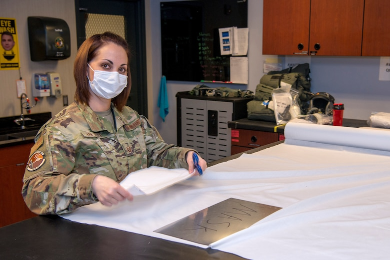 Tech. Sgt. Jennifer Van Note, an aircrew flight equipment specialist with the 140th Wing, Colorado National Guard at Buckley Air Force Base, Colorado, says she is proud to help make face masks for the community.