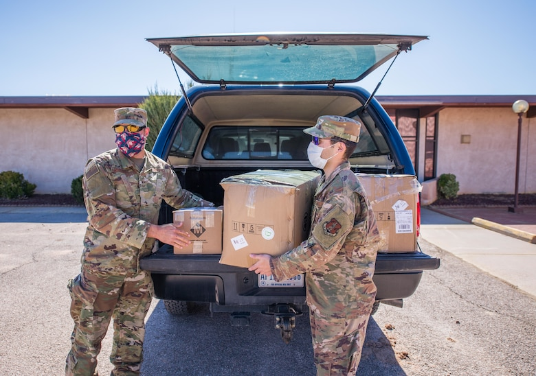 New Mexico Air National Guard Senior Airman Jason Quintana and Staff Sgt. Israel Martinez deliver personal protective equipment to Grants, New Mexico, to help support local communities.