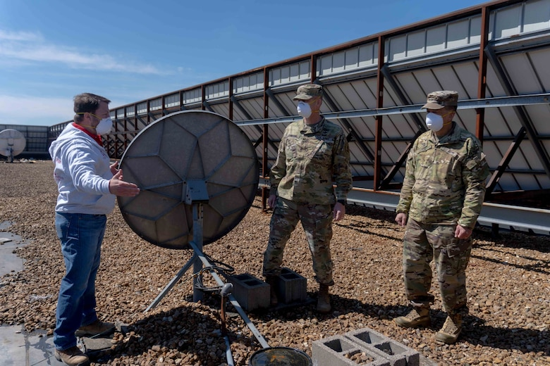 U.S. Army Maj. Gen. Mark Toy, Mississippi Valley Division commander, and Brig. Gen. Levon Cumpton, Missouri National Guard adjutant general, tour the alternate care site in St. Louis, Missouri, April 13, 2020. The site was developed to support health care facilities in the area. (U.S. Air National Guard photo by Senior Airman Audrey Chappell)