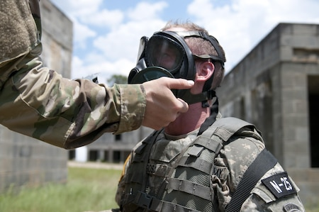 FORT BRAGG, N.C. - Staff Sgt. David Rosa, a psychological operations specialist representing the U.S. Army Civil Affairs and Psychological Operations Command, gets his gas mask checks by a drill sergeant while competing in the combat skills testing event at the 2017 U.S. Army Reserve Best Warrior Competition at Fort Bragg, N.C. June 14. This year's Best Warrior Competition will determine the top noncommissioned officer and junior enlisted Soldier who will represent the U.S. Army Reserve in the Department of the Army Best Warrior Competition later this year at Fort A.P. Hill, Va. (U.S. Army Reserve photo by Sgt. Jennifer Shick)