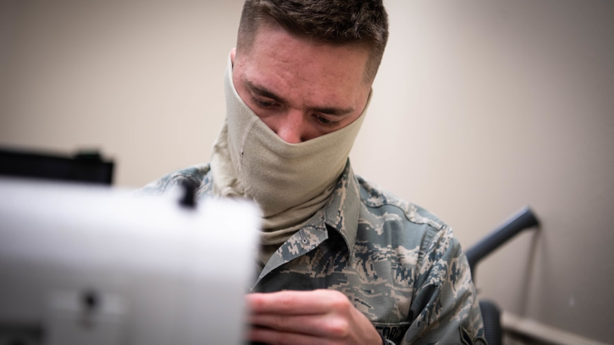Airman Alexander D. Neurohr, 2nd Operational Support Squadron aircrew flight equipment journeyman, sews a mask at Barksdale Air Force Base, La., April 16, 2020. All Airmen of the 2nd OSS AFE shop learned to sew as part of their technical training to repair aircrew equipment including parachutes, flight suits and other various equipment. (U.S. Air Force photo by Airman 1st Class Jacob B. Wrightsman)